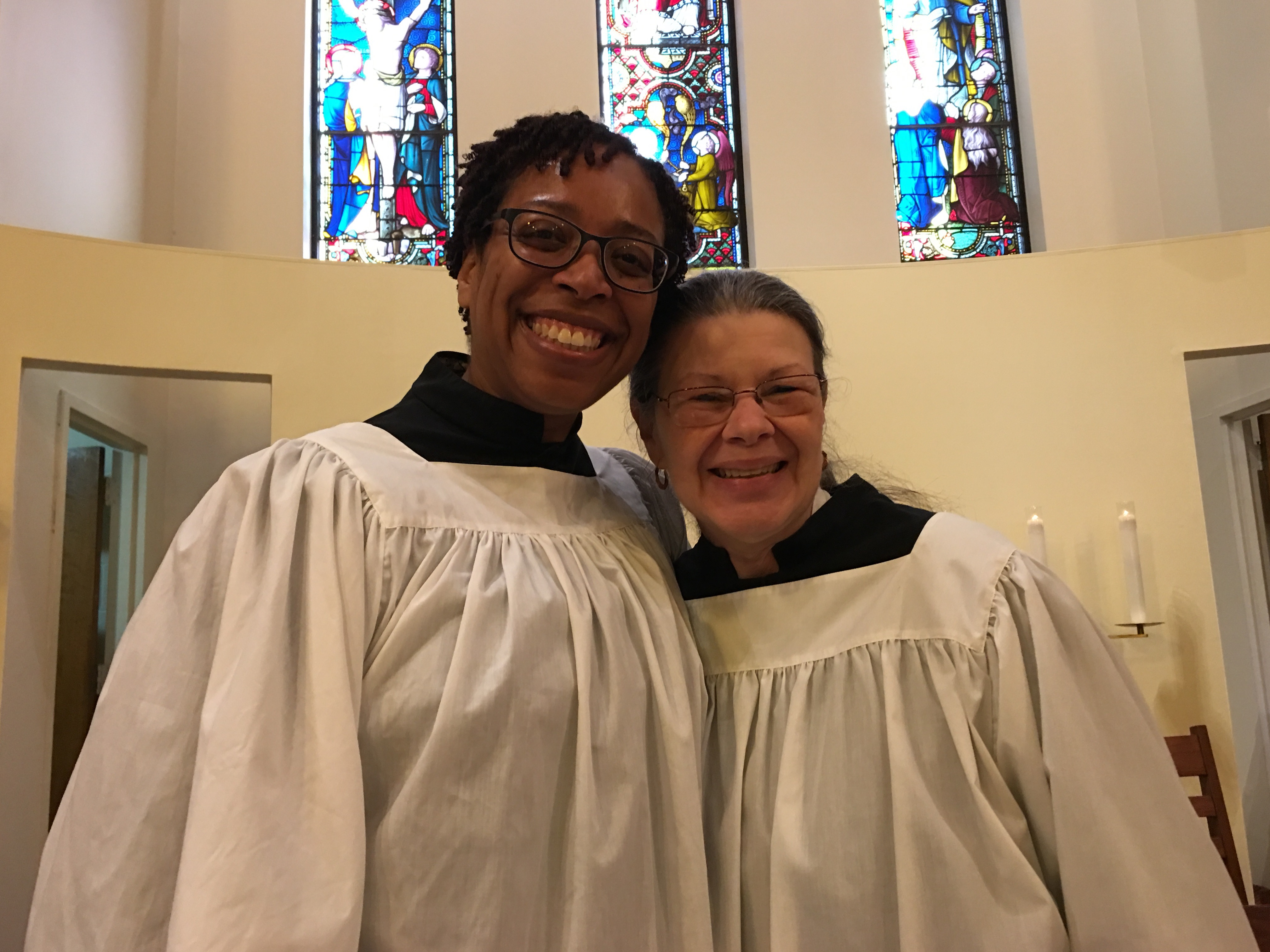 Newest choir members Christiane joins Evelyn on the altar